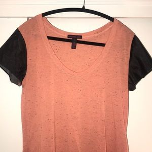 Coral tee with faux leather short sleeves.